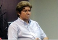 Prof Romulo